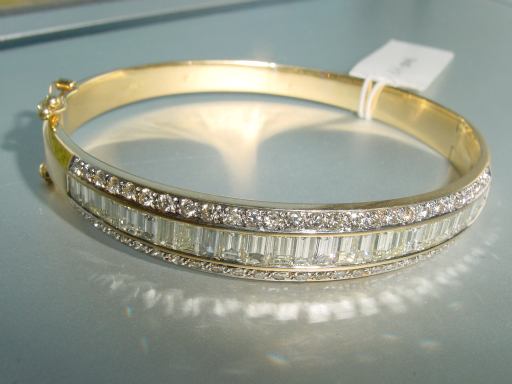 diamond set baguette aurora line gold white channel bracelet
